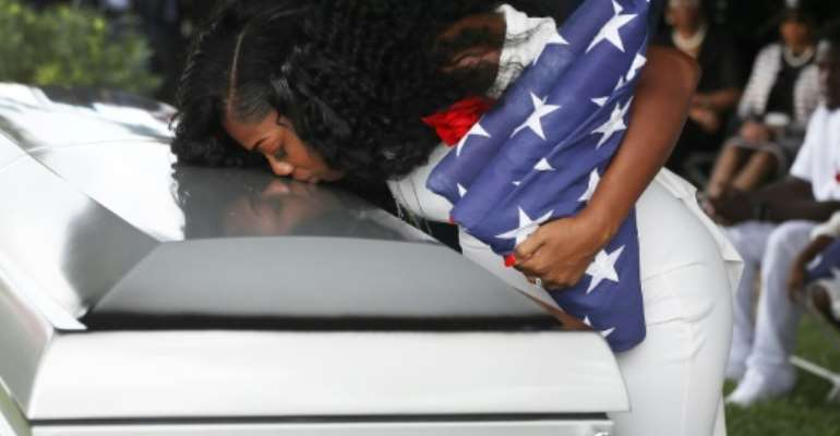 Myeshia Johnson kisses the casket of her husband US Army Sgt. LaDavid Johnson, who was killed in the October 4, 2017 ambush in Niger.  By JOE RAEDLE (GETTY IMAGES/AFP/File)