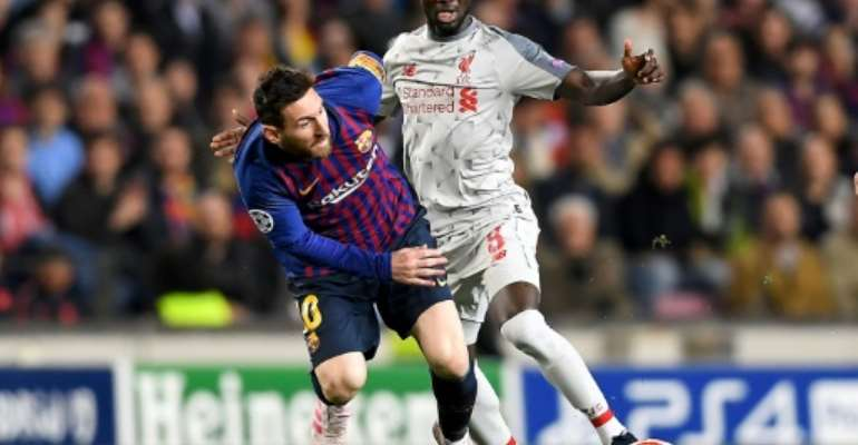 Naby Keita was hurt during the first leg of Liverpool's Champions League semi-final against Barcelona.  By JOSE JORDAN (AFP)