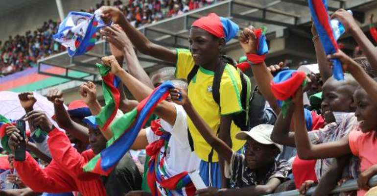 Namibian SWAPO supporters cheer during the last campaign rally on November 22, 2014 at the Sam Nujoma stadium in Windhoek.  By Jordaania Andima (AFP/File)