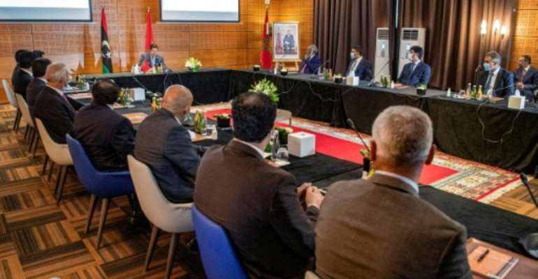 Nasser Bourita, Morocco's foreign minister, chairs a meeting of representatives of Libya's rival administrations in the coastal town of Bouznika, south of Rabat.  By FADEL SENNA (AFP)