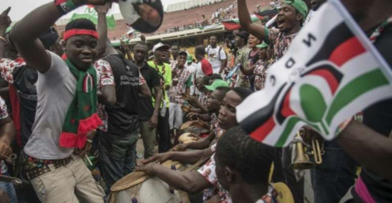 National Democratic Congress supporters at an election rally in the Accra Sports Stadium on December 5, 2016.  By Cristina Aldehuela (AFP)