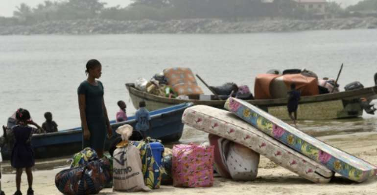 Navy personnel last week shot in the air and bulldozed houses as they cleared a community of some 10,000 people living on an island in Lagos.  By PIUS UTOMI EKPEI (AFP)
