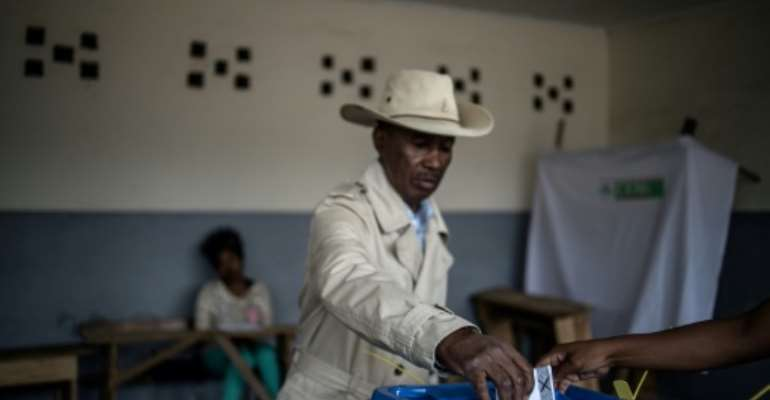 Nearly 10 million voters are eligible to cast ballots for one of 36 candidates.  By Marco LONGARI (AFP)