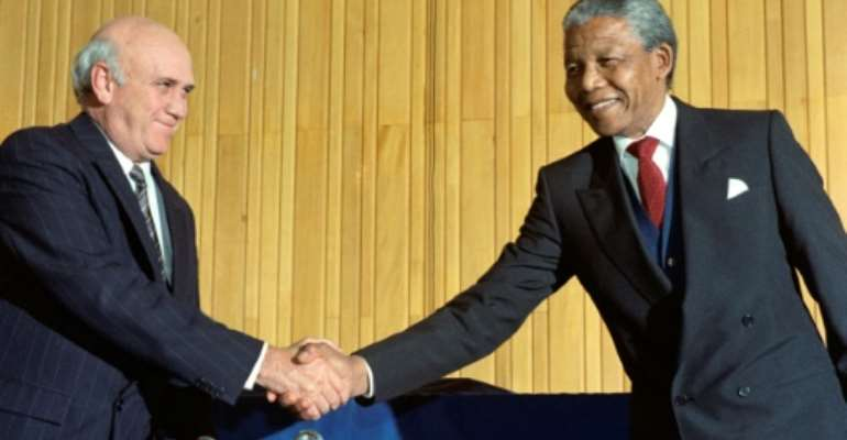 Nelson Mandela became the country's first black president taking over from FW de Klerk (L).  By RASHID LOMBARD (AFP/File)