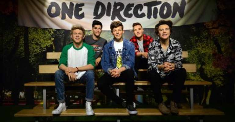 Madame Tussauds waxwork figures of One Direction, who will appear on the new Band Aid single.  By Carl Court (AFP)