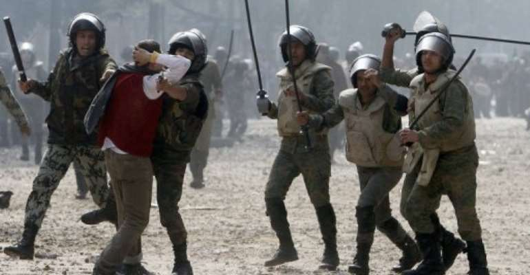 Violence erupted after a protester said he had been arrested by soldiers and beaten up.  By Mohammed Abed (AFP)