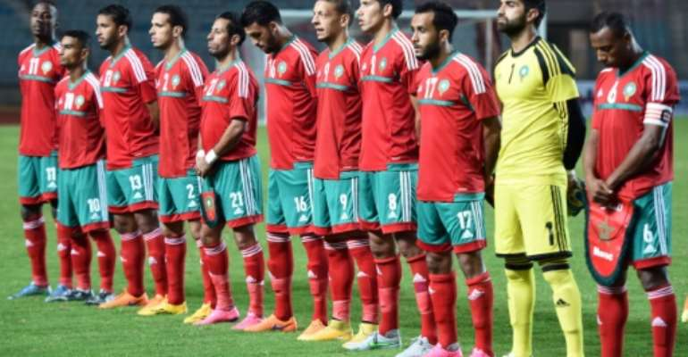 Morocco's national football team players pose for a photo ahead of their 2016 African Nations Championship qualifying match against Libya, in Rades Olympic Stadium outside Tunis, in October 2015.  By Fethi Belaid (AFP/File)