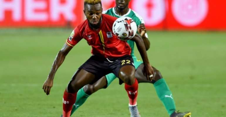 New Pyramids FC signing Lumala Abdu (F) playing for Uganda against Senegal in the Africa Cup of Nations last month.  By MOHAMED EL-SHAHED (AFP)