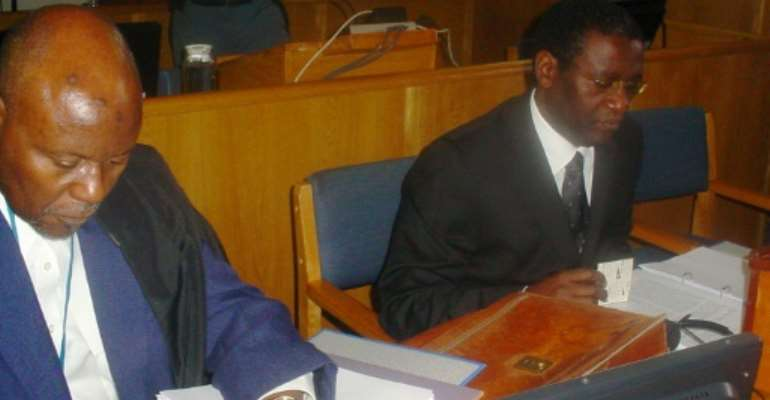 Ngirabatware, right, seated next to his lawyer at the start of his trial in 2008.  By EPHREM RUGURIRIZA (AFP)