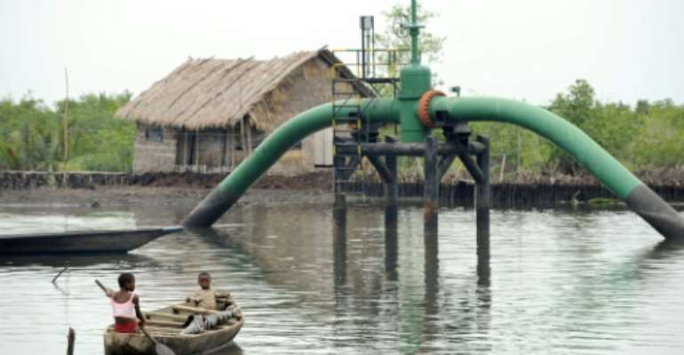 Nigeria, a major oil producer, aims to end a costly fuel subsidy system which has provided a lucrative source of funds for corrupt officials and businessmen but which the government says it can no longer afford given the coronavirus' economic impact.  By PIUS UTOMI EKPEI (AFP)