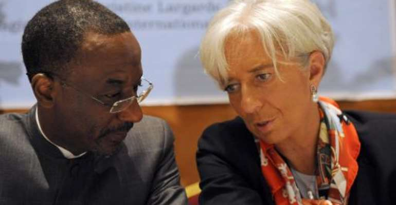 IMF Managing Director Christine Lagarde (right) talks with Lamido Sanusi at a meeting in Lagos on December 20, 2011.  By Pius Utomi Ekpei (AFP)