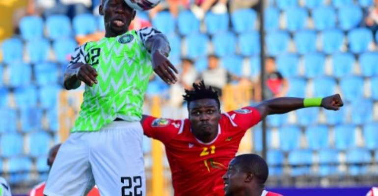 Nigeria defender Kenneth Omeruo outjumped the Guinea defence to score the winning goal.  By Giuseppe CACACE (AFP)