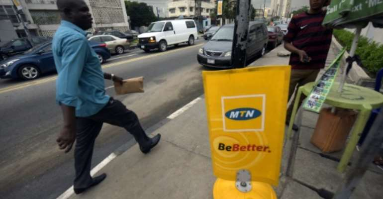 Nigeria expects MTN to meet a deadline for paying a record $3.9 bn fine despite a court challenge.  By Pius Utomi Ekpei (AFP)