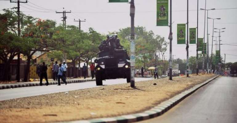 Nigerian police enforce a curfew in Bauchi, capital of Bauchi state, northern Nigeria, on April 18, 2011.  By Tony Karumba (AFP/File)