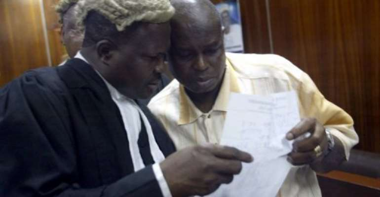 Former governor of oil-rich Bayelsa state Diepreye Alamieyeseigha seen (R) at the High Court in Lagos, January 24, 2006.  By Pius Utomi Ekpei (AFP/File)
