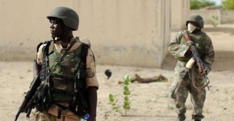 Nigerian soldiers patrol near Maiduguri on June 5, 2013.  By Quentin Leboucher (AFP)