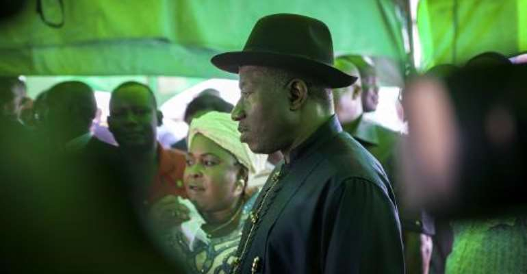 Nigerian president Goodluck Jonathan arrives to cast his ballot during presidential elections at a polling station in Otuoke on March 28, 2015.  By Florian Plaucheur (AFP/File)