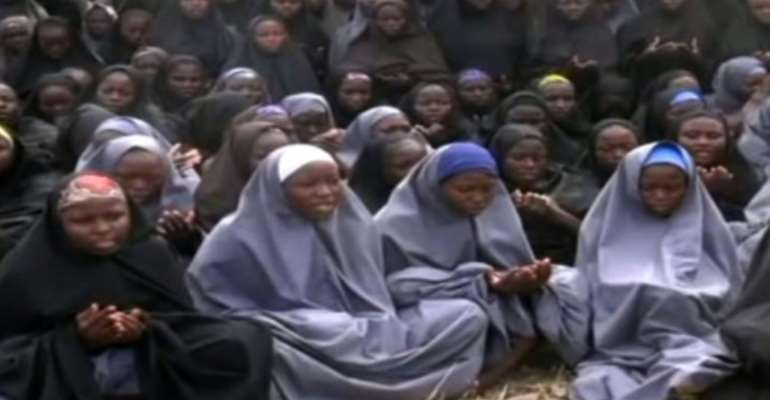 A screengrab taken from a video of Nigerian Islamist extremist group Boko Haram obtained by AFP showing girls, wearing the full-length hijab and praying in an undisclosed rural locationon May 12, 2014.  By HO (BOKO HARAM/AFP/File)
