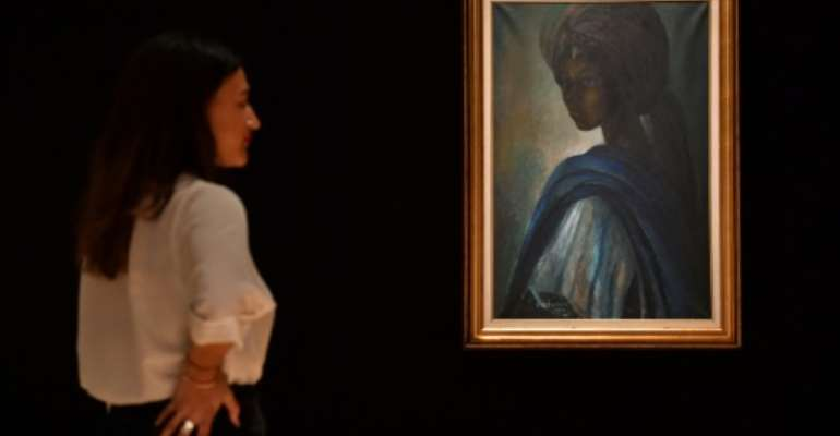 Nigerian artist Ben Enwonwu's work entitled 'Tutu' - the African Mona Lisa -- was one of the works that captured the emergence of Nigeria's art market.  By BEN STANSALL (AFP)