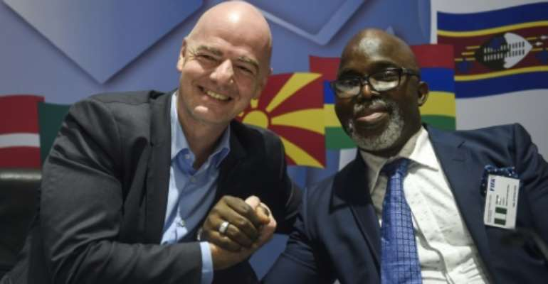 Nigerian football boss Amaju Pinnick (R) with FIFA president Gianni Infantino..  By PIUS UTOMI EKPEI (AFP)