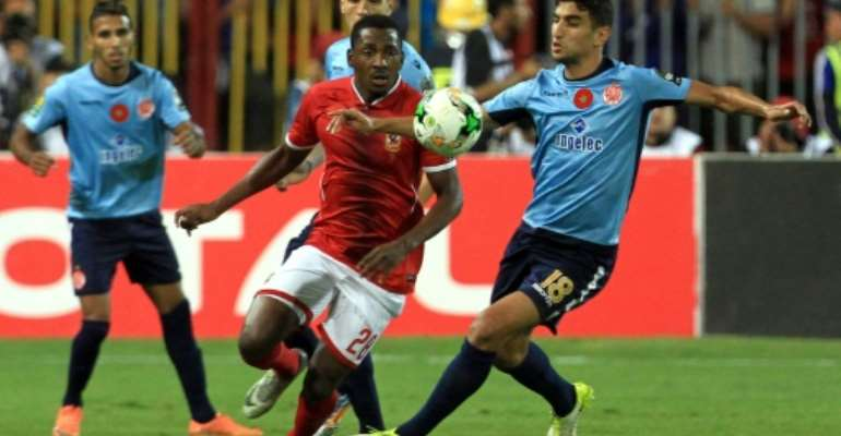 Nigerian forward Junior Ajayi (C) is one of the foreign stars in the Al Ahly squad.  By  (AFP/File)