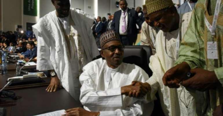 Nigerian President Muhammadu Buhari signs onto the landmark African trade deal at the AU summit in Niamey.  By ISSOUF SANOGO (AFP)