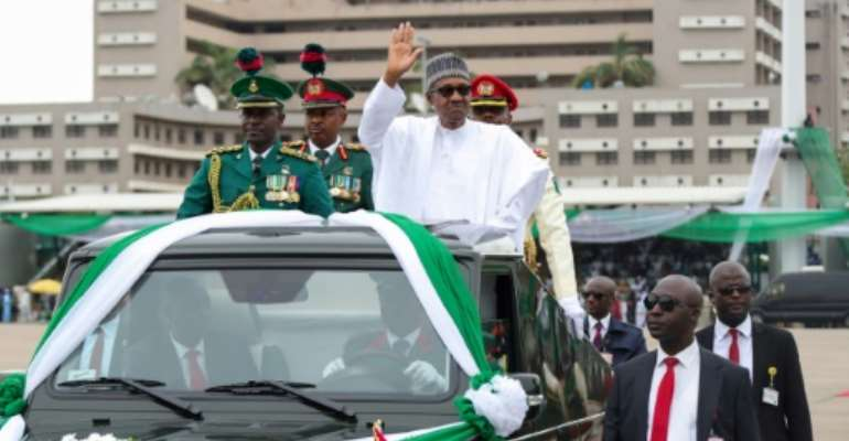 Nigerian President Muhammadu Buhari was inaugurated Wednesday vowing to tackle security threats and root out corruption.  By Sunday Aghaeze (Nigerian Presidential Press Services/AFP)