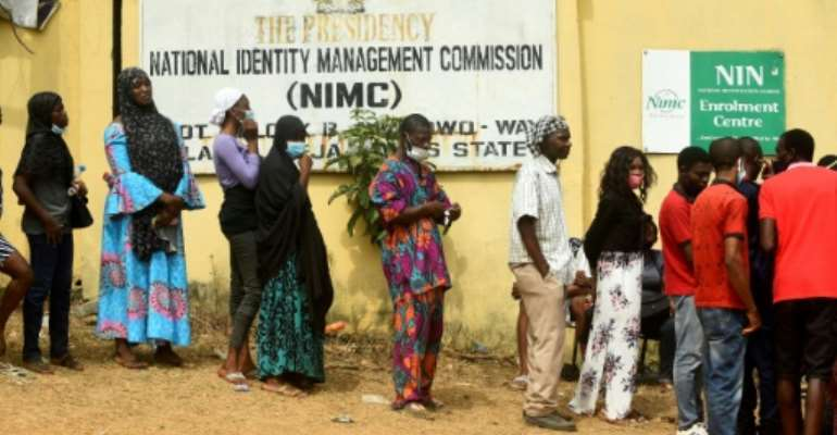 Nigerians queue to obtain the precious National Identity Number -- without it, their mobile phone may be cut off.  By PIUS UTOMI EKPEI (AFP)