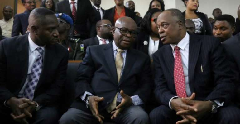 Nigeria's Chief Justice Walter Onnoghen (C, pictured February 2019) was charged with failing to declare foreign currency bank accounts, in contravention of rules governing declaration of assets for public officials.  By - (AFP/File)