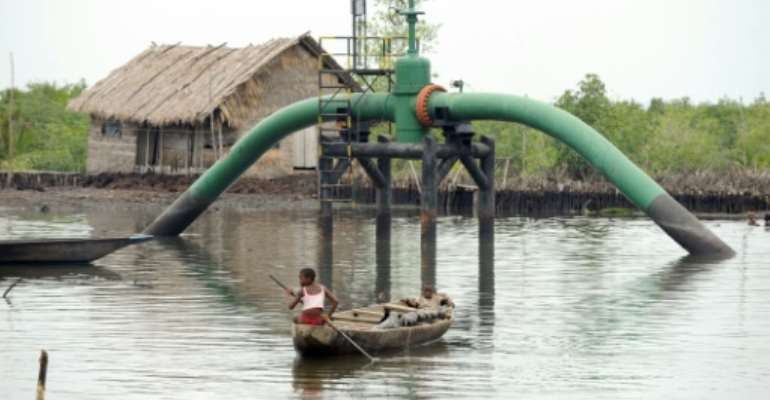Nigeria produces some two million barrels of crude oil a day but despite its huge reserves, the country imports much of its fuel due to a lack of refining capability -- a situation blamed on corruption and mismanagement.  By Pius Utomi Ekpei (AFP/File)