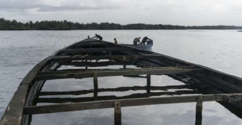 Nigeria's oil-rich Niger delta is prone to corruption and mismanagement, officials say. Here we see an abandoned boat filled with oil near the city of Port Harcourt.  By STEFAN HEUNIS (AFP/File)