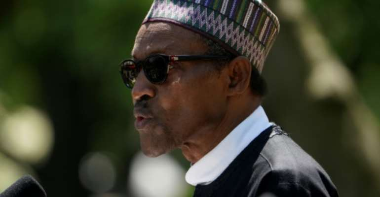 Nigeria's President Muhammadu Buhari is said to be experiencing tensions with his main political backer, but the leader played down internal disagreements within the party.  By Mandel NGAN (AFP/File)