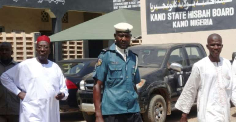 Nigeria's sharia enforcement agency Hisbah, seen here in Kano state, ruled the men had made a mockery of Islam with a false Facebook wedding that caused uproar.  By AMINU ABUBAKAR (AFP)