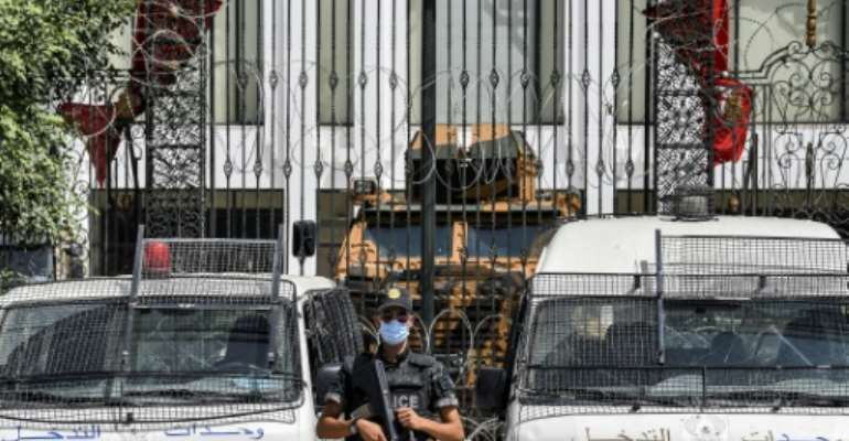 No entry: an armoured car and security forces stand guard outside parliament in Tunis on July 31, 2021.  By FETHI BELAID (AFP)