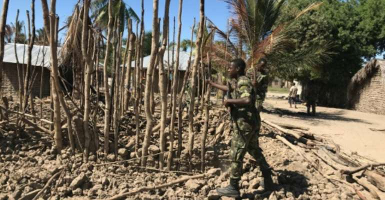 Northern Mozambique has suffered a string of deadly attacks by a shadowy jihadist group since October 2017. Pictured: the aftermath of a raid on the village of Naunde in June 2018 in which seven people were hacked to death and 164 homes torched.  By Joaquim Nhamirre (AFP)