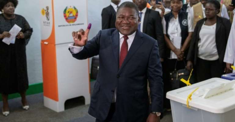 Nyusi is forecast to win a second five-year term despite his popularity taking a hit from chronic unrest and a financial crisis linked to alleged state corruption.  By GIANLUIGI GUERCIA (AFP)