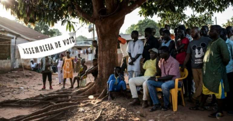 Officials count first-round votes at a polling station in the popular Bairro Militar area of Bissau in November 2019.  By JOHN WESSELS (AFP/File)
