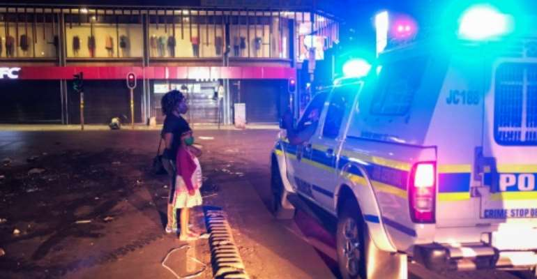 Officials have ramped up efforts to enforce restrictions in South Africa.  By Wikus de Wet (AFP/File)
