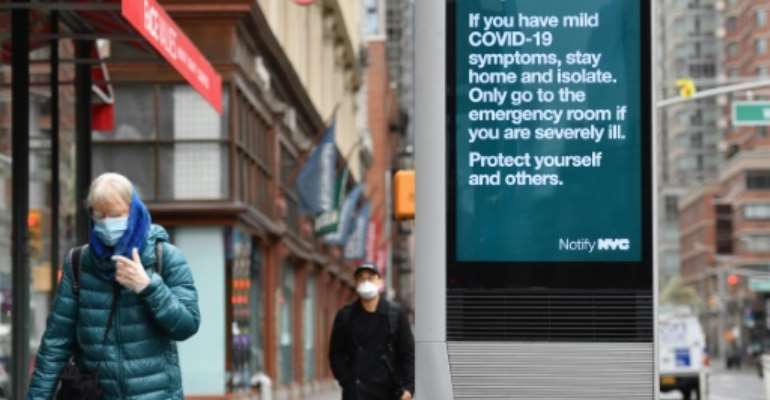Officials in New York, the worst affected part of the US, began advising people to wear masks some days ago, and there were signs on the streets that the advice was being heeded.  By Angela Weiss (AFP)