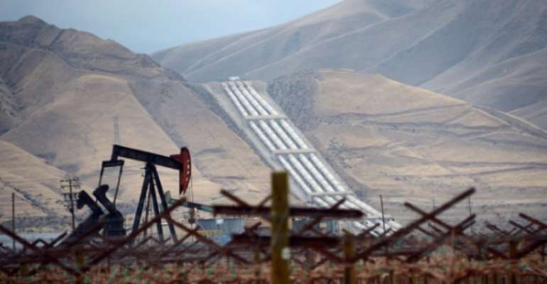 Oil prices are sitting around two-decade lows, hit by the virus and a Saudi-Russia battle for market share.  By Frederic J. BROWN (AFP)