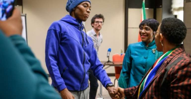 Olympic champion Caster Semenya meets South Africa's Sports Minister Tokozile Xasa and South Africa's ambassador to the United Nations in Geneva, Nozipho Joyce Mxakato-Diseko.  By Fabrice COFFRINI (AFP/File)