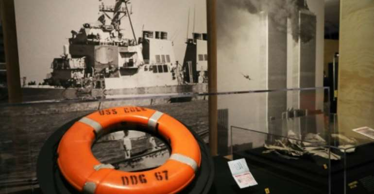 On October 12, 2000, a rubber boat loaded with explosives blew up as it rounded the bow of the USS Cole guided-missile destroyer.  By mheine (afp.com)