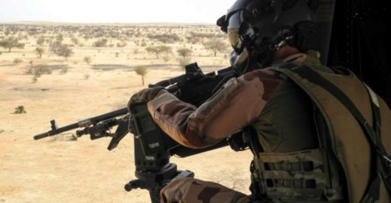 On patrol: France has committed more than 5,000 troops to its anti-jihadist force in the Sahel.  By Daphné BENOIT (AFP)