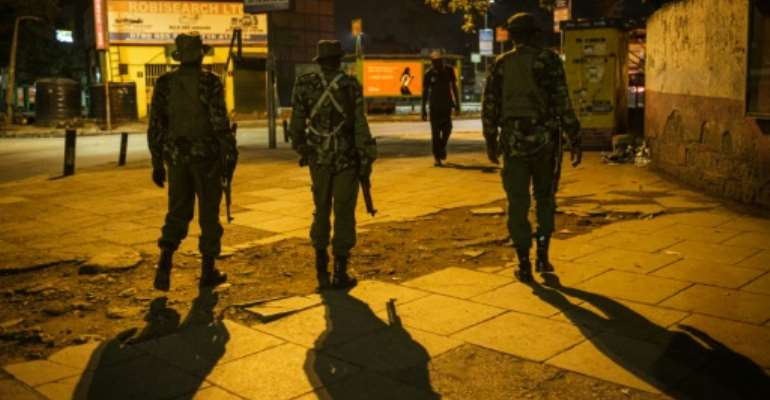 On patrol: Police in central Nairobi during the 7pm-5am curfew.  By Yasuyoshi CHIBA (AFP)