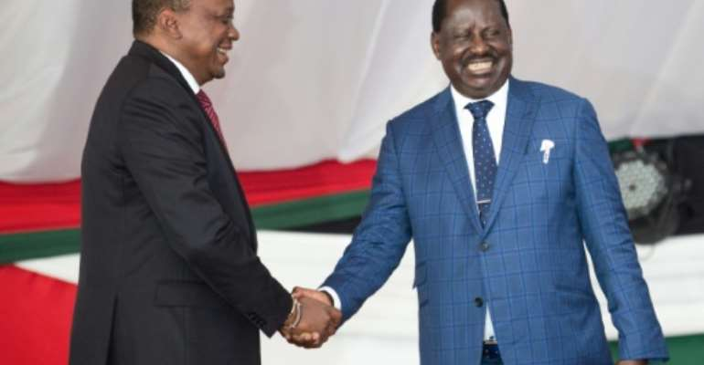 Once were rivals: President Uhuru Kenyatta, left, and opposition leader Raila Odinga at an annual prayer breakfast for national unity in May 2018..  By Evans OUMA (AFP)