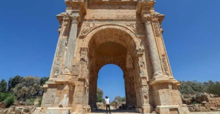 One of the few visitors to the ancient Roman city of Leptis Magna in Libya looks at the Arch of Septimius Severus.  By Mahmud TURKIA (AFP)