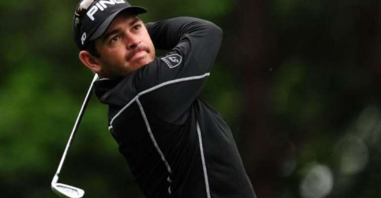 Louis Oosthuizen of South Africa tees off on the fourth hole.  By Robyn Beck (AFP)