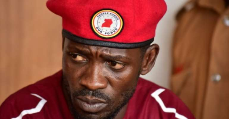 Opposition figurehead Bobi Wine was arrested for staging an illegal protest in 2018 -- charges fellow opposition MPs decried as ridiculous.  By Nicholas BAMULANZEKI (AFP/File)