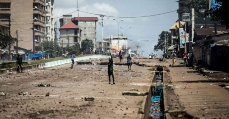 Opposition leader Cellou Dalein Diallo's self-proclaimed victory at Guinea's presidential election on October 18, 2020 led to a week of clashes between supporters and security forces across the West African nation (Conakry pictured October 23, 2020).  By JOHN WESSELS (AFP/File)
