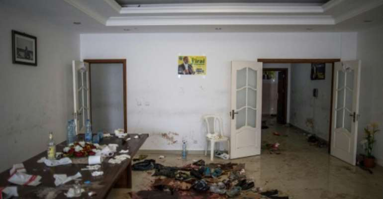 Opposition leader Jean Ping's headquarters were attacked after the vote.  By MARCO LONGARI (AFP/File)